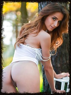 Newcomer Cara Mell sensually poses in the forest as she...