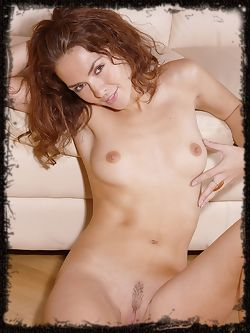 Olga has brown hair and has nice eyes and smiles allot ,...