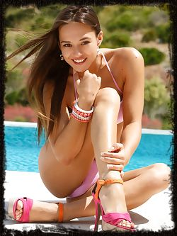 Poolside in her pink bikini and peep-toe stilettos,Dominika...