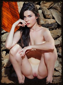Serena Wood shows off her gorgeous, sexy body and she sensually poses by the rocks.