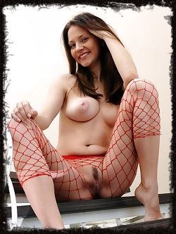 Sexy brunette in red fishnet stockings.