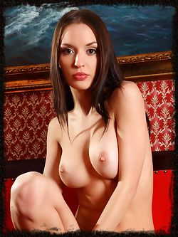 Silky dark haired beauty struts her naked body and shows...