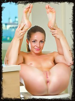 Susana C shows off her flexible, naked body in the...