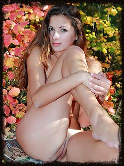 This flower girl runs naked through the rose garden, she has a spankable bottom and small breasts.