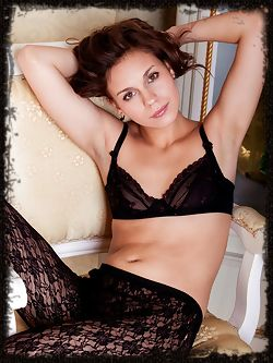 Tirata looks seductive in black lace lingerie and black...