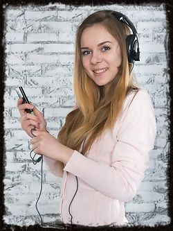 Top model Katie A playfully poses with her headphones....