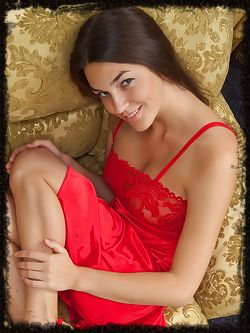 Vanda wears a bright red dress and matching stiletto shoes...