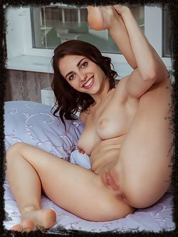 With a sweet smile, Mercedes shows off her bare body and...