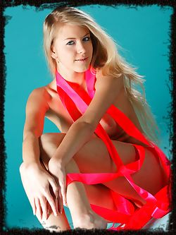 With bright pink strips of ribbons hugging her luscious...