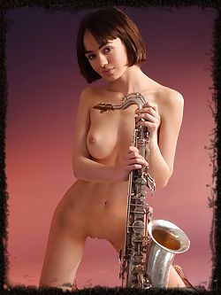 Young sweet girl loves jazz music and sexy instruments of...