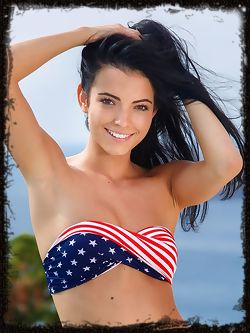 A gorgeous Sapphira A wearing an American flag shirt with...