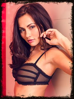 A sizzling hot Michaela Isizzu posing in her black mesh...