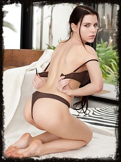 Adorned in sexy black lingerie lying on a zebra rug Valeria...