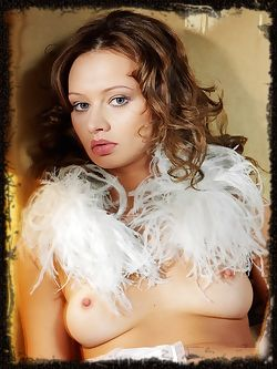 Alluring brunette in ultra sexy feather and lace ensemble....