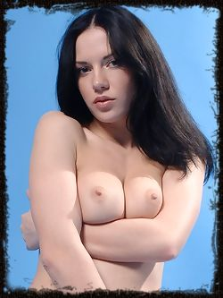 Blue background is accents a dark haired model with a full...