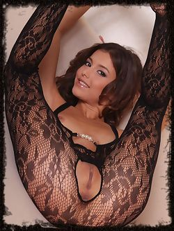 Divina A strips her full body lingerie as she bares her...
