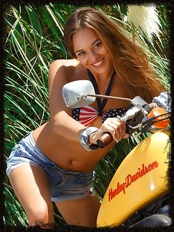 Dominika A looks stunning naked on a motorcycle...