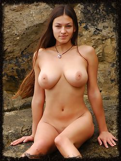 Flexible Sofia A poses nude on the rocks
