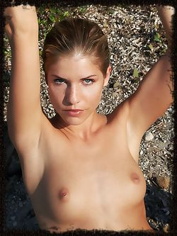 Iveta B's delicate, nubile beauty emanates from the rugged...
