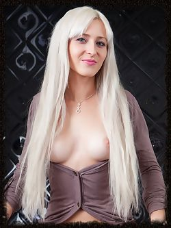Janelle B has long platinum hair and a tight body...
