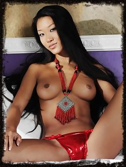 Mariko is an Asian bombshell with long dark hair a smoking...