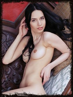 Alluring Dita V bares her long, slender body and perky tits...