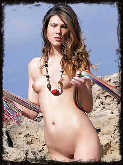 Chiara is out on the beach with her panties someplace else, she has small breasts with precious nipples out in the sun.