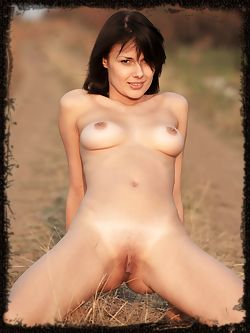 Fun girl with a smile and an athletic body runs nude in the...