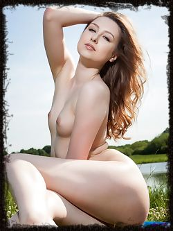 Ginger Frost displays her creamy, white body and pink pussy...