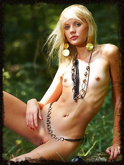 Happy blonde is petite and sensual as she lays outside in...