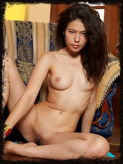 Jackie D and her hypnotizing look as she lounges naked by...
