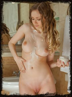 Lenore flaunts her slender, naked body with smooth pussy as...