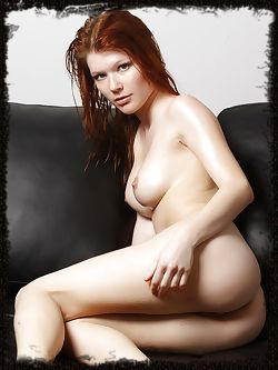 Mia Sollis rubs oil all over her body...