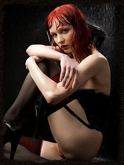 New model has a Goth look to her with milky white skin and fire red hair and the look of evil beauty.