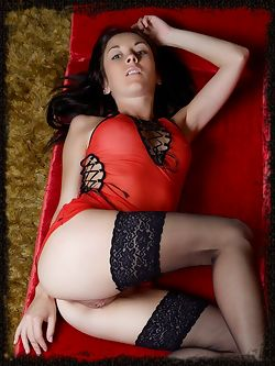 Night A's lean legs garbed in sheer black stockings while...