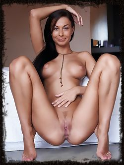 Perfect silky long black hair caresses full breasts with...