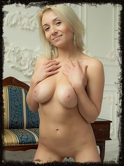 Pretty blonde Isabella D playfully poses naked for the...