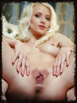 Stunning blonde Nika N posing naked on her vanity...