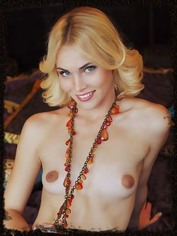 Wearing nothing but an amber necklace, Cordelia A flaunts...